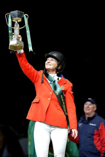 The USA's Beezie Madden holds the trophy aloft after her sensational victory with Simon at the Rolex FEI World Cup™ Jumping Final 2012/2013 in Gothenburg, Sweden today.  Photo: FEI/Kit Houghton