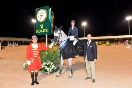Peter Nicholson from Rolex USA presents Ben Maher with his Rolex watch.