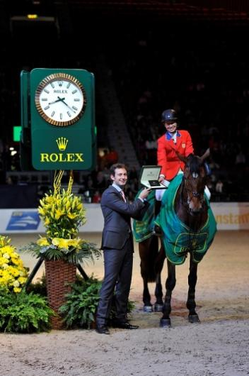 America's Beezie Madden and Simon won the first of the three deciding competitions at the Rolex FEI World Cup™ Jumping Final in Gothenburg, Sweden tonight. She is pictured being presented with her prize by Anthony Schaub from Rolex.  Photo: FEI/Kit Houghton.
