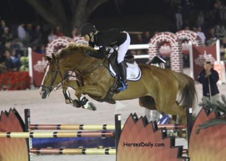 Ashlee Bond Clark and the 2004 Mexican Sport Horse mare Chela LS retired during the jump off to maintain their placings. Photo: Mary Phelps