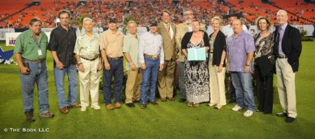 Members of the Brady family and a group of farriers accepted Seamus Brady's award on his behalf (photo © The Book LLC)