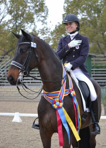 """Brandi Roenick was all smiles after topping the CDI Young Rider division on """"Pretty Lady"""" as well as the Intermediaire Freestyle with """"Nobel"""".  (Photo: Jennifer M. Keeler)"""