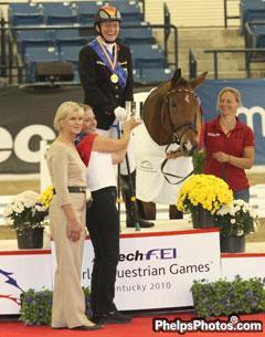 Gold medallist Germany's Hannelore Brenner with Kentucky's First Lady Jane Beshear and Alston M. Kerr World Equestrian Foundation Chairperson