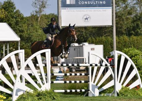 Brianne Goutal rode Uata to victory in the ,000 Wolffer Estate Open Jumper at the Hampton Classic. (Shawn McMillen photo)