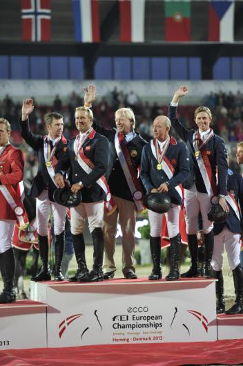 The British made history again today when adding the PSI FEI European Team Jumping Championship 2013 title to last summer's Olympic team gold.  Pictured (L to R): Scott Brash, Will Funnell, Chef d'Equipe Rob Hoekstra, Michael Whitaker and Ben Maher.  Photo: FEI/Kit Houghton.
