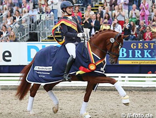 Beatrice Buchwald and Lord Carnaby win the 6-year-old division at the 2013 Bundeschampionate (Photo: Photo © LL-foto)