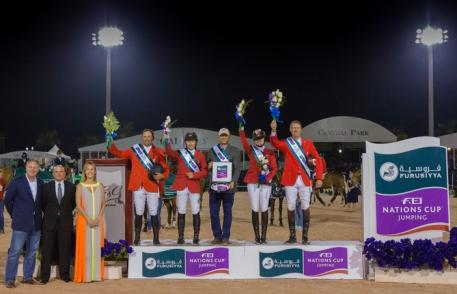 Team Canada picked up maximum points when winning tonight's second leg of the Furusiyya FEI Nations Cup™ Jumping 2014 series at Wellington in Florida (USA).  Left to right on the podium: Yann Candele, Eric Lamaze, Tiffany Foster and Ian Millar, with Chef d'Equipe Mark Laskin. Photo: FEI/StockImageServices.com