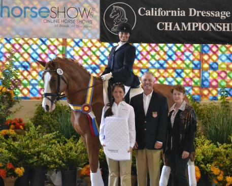 """Bettina Loy and """"Carette MG""""(owned by Rya Lahti) win the CDS Young Horse Futurity for Five-Year-Olds.  Awards presented by (l-r) Anne Margaret Meyers of HorseShow.com; U.S. Olympic Dressage Team member Jan Ebeling; and CDS Board Member Ellen Corob. (Photo: Jennifer M. Keeler)"""