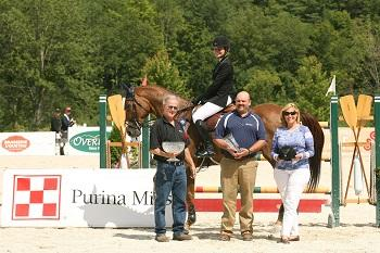 Catherine Tyree and Sandor de la Pomme, pictured with Bob Gunnison and Troy Pride of Purina Horse Feed, are presented as winners of the ,000 Manchester and the Mountains Grand Prix, presented by Purina Horse Feed. Photo by David Mullinix Photography