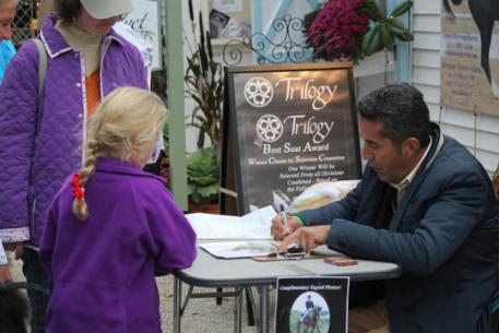 Dr. Cesar Parra signing autographs at the Trilogy both at Dressage at Devon.