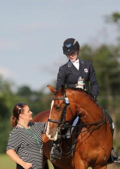 Catherine's mom Annie with Verdicci aftet winning Individual Young Rider Dressage Gold