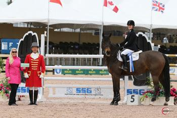 Chloe D. Reid claimed her second bonus of the year from SSG Gloves after winning the ,000 Junior Jumper Classic on February 9 riding Athena.  Presenting on behalf of SSG Gloves is Jennifer Ward with ringmaster Gustavo Murcia. Photo by Sportfot