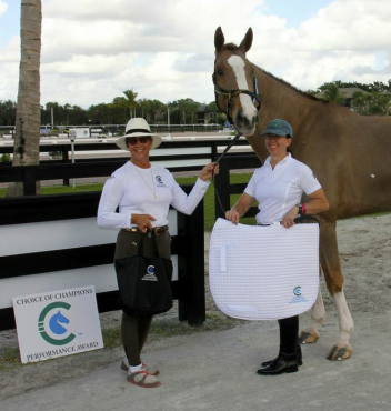 Photo: Allyn Maix (left) of Choice of Champions presents Heather Mason and Zar with the Choice of Champions Performance Award.