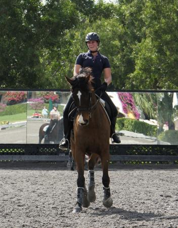 Photo Caption: Champus 4, donated more than two years ago to Dressage4Kids - Corie Bannon's dressage horse
