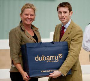 Lisa Coulter (left) receives her DuBarry boots from Danny Hulse.(Shannon Brinkman photo)
