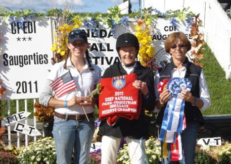 "Dr. Dale Dedrick flanked by her ""team"" Meagan Ferrari-Szarek and trainer Roz Kinstler the Reserve Champion of the 2011 USEF National Para Equestrian Dressage Championships."