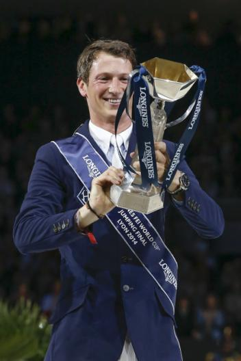 All mine!  Germany's Daniel Deusser looks with delight at the Longines FEI World Cup™ Jumping trophy which he won today following a superb performance with Cornet d'Amour.  Photo: FEI/Dirk Caremans.