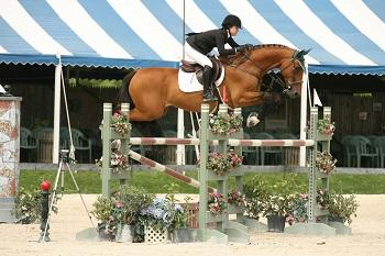 Danielle Torano and Capitano won the ,000 Show Jumping Hall of Fame High Junior/Amateur-Owner Classic July 21 at the Vermont Summer Festival in East Dorset, VT. Photo by David Mullinix Photography