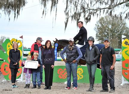 Winner's awards, including a Horze Equestrian cooler, are presented to David Beisel and Ammeretto after the ,000 SmartPak Grand Prix, presented by Zoetis at HITS Ocala. ©ESI Photography