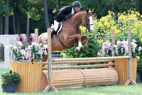 "David Oliynyk and Generous rode to the top of the ,000 NEHJA 3'3"" Hunter Derby Finals during the Fieldstone Summer Showcase II."