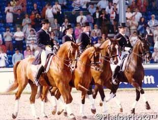 The 1994 WEG bronze medal U.S. team: Robert Dover on Devereaux, Kathleen Raine on Avontuur, Carol Lavell on Gifted, and Gary Rockwell on Suna (Photo: © Mary Phelps)