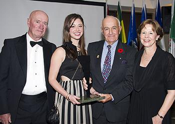 Jim Henry, Kaitlin Henry Armstrong, and Nancy Armstrong accepted the award from Jim Elder (second from right) on behalf of Doug Henry. Photo by Michelle C. Dunn