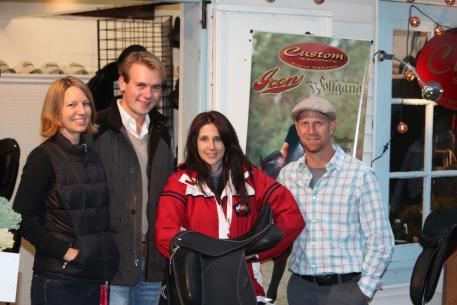Heather Drake holds her new Custom Saddlery dressage saddle and is accompanied by Endel Ots, Tracie Montgomery(left) and Frank Taht (right).