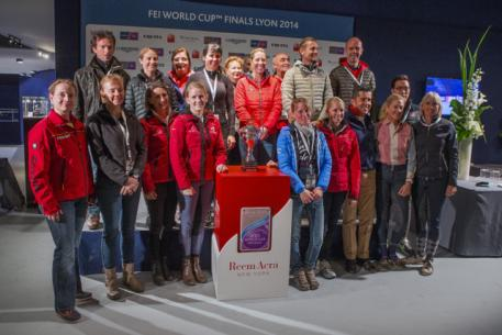 All 18 riders gathered for the draw for the first leg of the Reem Acra FEI World Cup™ Dressage Final 2013/2014 which begins tomorrow in Lyon, France with the Grand Prix. Standing to the left of the trophy is defending champion Helen Langehanenberg from Germany.  Photo: FEI/Dirk Caremans.
