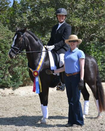 "Small but mighty: pony ""Donar's Diablo"" won the CDS Training Level Open Horse of the Year title, with rider Kelly Phillips and owner Kim Crandall. (Photo: Jennifer M. Keeler)"