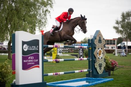 The Swiss team of Pius Schwizer, Romain Duguet, Paul Estermann and Steve Guerdat won the opening leg of the Furusiyya FEI Nations Cup™ Jumping Europe Division 1 series at Lummen, Belgium today without Olympic champion, Guerdat, having to jump a single fence.  Pictured are Romain Duguet and Quorida de Treho who produced one of the three double-clear performances that clinched it for the Swiss side. Photo: FEI/Dirk Caremans.