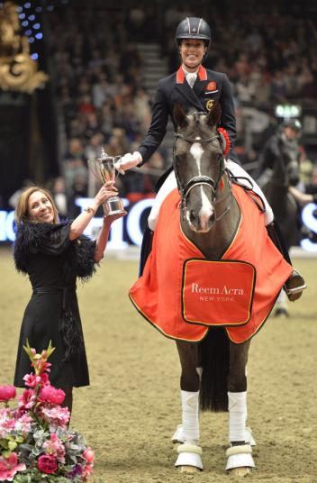 New York fashion designer and sponsor, Reem Acra, with Great Britain's Charlotte Dujardin and Valegro who broke the Freestyle world record at Olympia, London (GBR). (Photo: FEI/Kit Houghton)