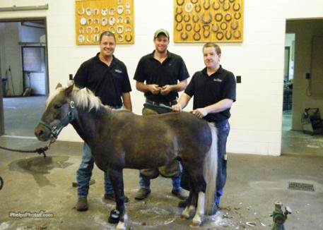 The team at the  Rood and Riddle Equine Clinic Podiatry Center. Dr. Scott Morrison, Brian Beasley, and Scott Muir with Dusty