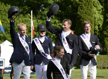 The Netherlands won the eighth leg of the Furusiyya FEI Nations Cup™ Jumping 2013 series at Copenhagen, Denmark today.  Pictured on the podium are (left to right) William Greve, Suzanne Tepper, Jur Vrieling and Hendrik-Jan Schuttert.  Photo: FEI/Annette Boe Ostergaard.