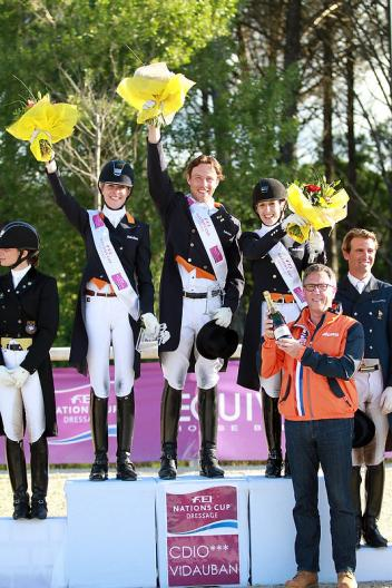 The Netherlands emerged victorious at the opening leg of the FEI Nations Cup™ Dressage pilot season at Vidauban, France yesterday.  Pictured on the podium are Katja Gevers, Laurens van Lieren and Stephanie Peters with trainer, Wim Ernes. (Photo: FEI/Rui Pedro Godinho)