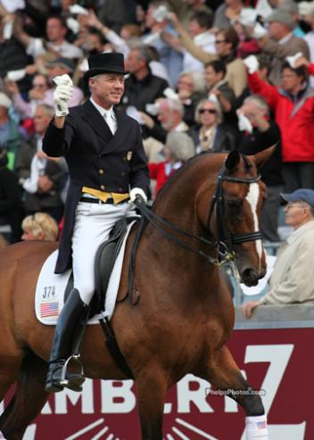 "Jan Ebeling and Rafalca in the legendary ""Farewell to the Nations"" at the closing ceremonies at Aachen 2011. Representing the USA Nations Cup Team, Ebeling waves the ""Aachen hanky"" to the responding crowd. (photo: Mary Phelps - phelpsphotos.com)"