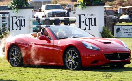 Taking Menezes for a spin in a Ferrari after the win. Photo courtesy of CapturedMomentPhoto.com
