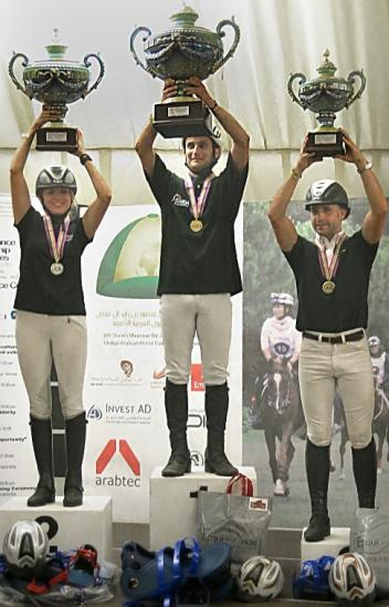 On the podium for the FEI World Endurance Championships for Young Horses in Valeggio Sul Mincio (ITA) are: (L to R) silver medallist Silvia Yebra Altimiras (ESP), gold medallist Aurelien Rocchia (FRA) and bronze medallist Laurent Mosti (FRA). (Photo: Gilly Wheeler/FEI).