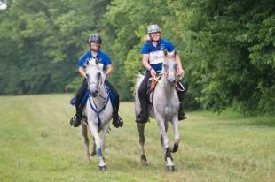 Endurance Team gold medallists Cassandra Roberts and Golden Lightning (left) and Morgan Watson and My Lords Elisha (right) also took Individual silver and gold for the Southeast Region at the FEI North American Championships for Juniors and Young Riders 2014 at Kentucky Horse Park in Lexington, USA.  Photo: StockImageServices.com/FEI