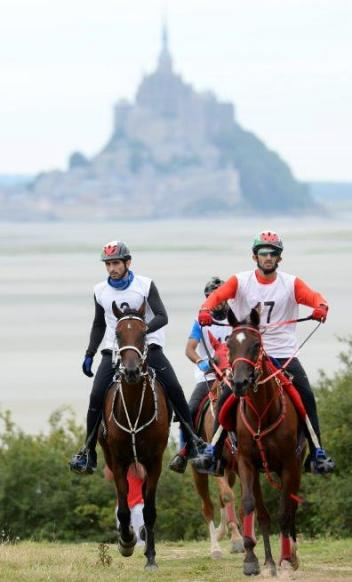 Winners HE Sheikh Hamdan bin Mohammed Al Maktoum (left) and Nikos, with HE Sheikh Rashid Dalmook Al Maktoum and Yamamah pictured in front of the iconic Mont Saint-Michel at today's Endurance test event for the Alltech FEI World Equestrian Games™ in Normandy 2014. (Photo: Philippe Millereau KMSP)