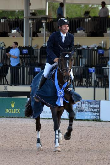Eric Lamaze and Zigali P S, owned by Artisan Farms, celebrate their victory in the ,000 WEF Challenge Cup Round XI on March 20 at the FTI Consulting Winter Equestrian Festival in Wellington, FL. Photo by Starting Gate Communications Inc.
