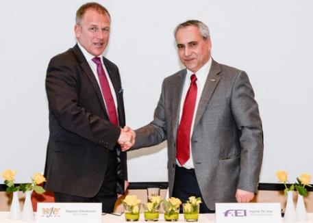 ISJC President Stephan Ellenbruch (left) and FEI Secretary General Ingmar De Vos celebrated the signing of the ISJC's Memorandum of Understanding with the FEI during an ISJC FEI Refresher Seminar for FEI Judges in Basel (SUI). (Carlo Stuppia/FEI).