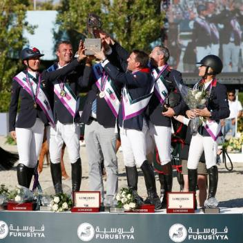 Furusiyya FEI Nations Cup™ Jumping Final 2013 - Team France (left to right) Pénélope Leprevost, Aymeric de Ponnat, Chef d'Equipe  Philippe Guerdat (partially obscured), Simon Delestre, Patrice Delaveau and Eugenie Angot celebrating victory in the world's richest team event, the Furusiyya FEI Nations Cup™ Jumping Final in Barcelona. Credit: FEI/Tomas Holcbecher