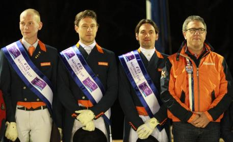 The Netherlands team of Diederik van Silfhout, Laurens van Lieren and Tommie Visser with Chef d'Equipe Wim Ernes on the top step of the podium following their victory at the second leg of the FEI Nations Cup™ Dressage 2014 pilot series at Vidauban, France tonight. (Photo: FEI/Rui Pedro Godinho)