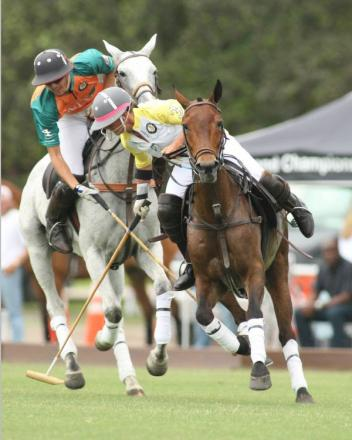 France's top woman polo player and GPL member on the Cedar Crest Stables Team, Caroline Anier, is pressured with a hook by Nacho Badiola on the Wellington Preservation Coalition Team.Photo by Alex Pacheco