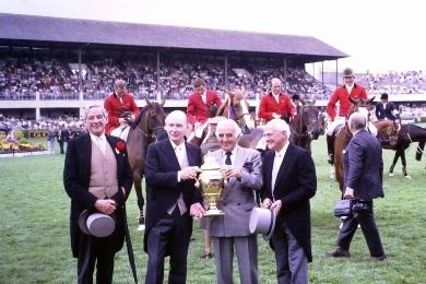 Frank O'Reilly of Ireland (left), who has died aged 90, is pictured here at the 1988 Dublin Horse Show with the then President of Ireland Patrick J. Hillery, and British Chef d'Equipe Ronnie Massarella holding the Aga Khan trophy. ©RDS
