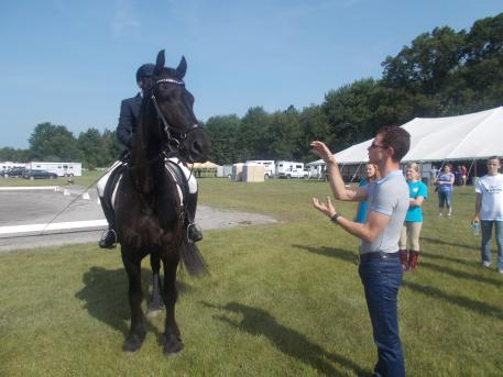 Nicholas Fyffe coaching riders after their ride at the Dressage4Kids event in Michigan.