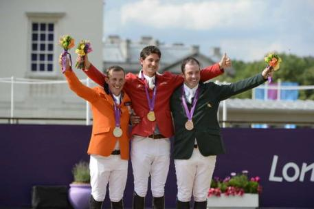 Gerco Schroder, Steve Guerdat and Cian O'Connor celebrate victory in the individual jumping final (Photo: Diana DeRosa)