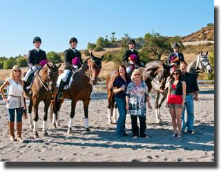 Riders pose with Nicole Bhathal, Kristin Young (Co-Chair, CDS San Juan Capistrano Chapter), and the Kearns Family.