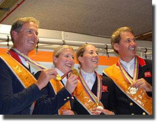 Gold winning British team, from left to right Carl Hester, Laura Bechtolsheimer, Carl's pupil Charlotte Dujardin and Emile Faurie