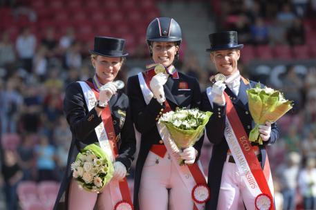 Britain's Charlotte Dujardin and Valegro won the Grand Prix Special at the Blue Hors FEI European Dressage Championships 2013 in Herning, Denmark today. Pictured on the podium (L to R): silver medallist Helen Langehanenberg (GER), gold medallist Charlotte Dujardin (GBR) and bronze medallist Adelinde Cornelissen (NED). (Photo: FEI/Kit Houghton)